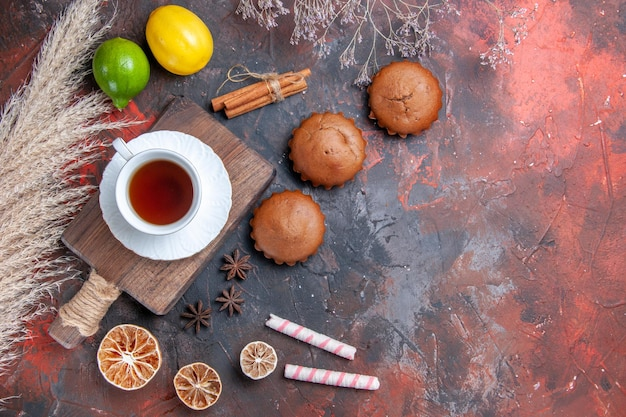Cupcake citrus fruits cinnamon star anise a cup of tea on the board