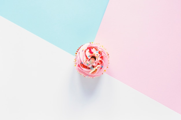 Cupcake on colorful background