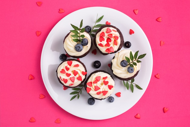 Cupcake decorated with hearts. love. valentine's day concept. top view.