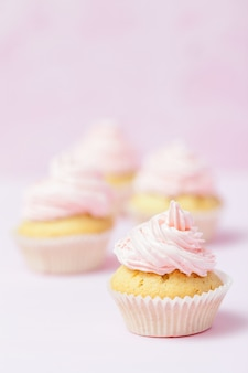 Cupcake decorated with pink buttercream on pastel pink background. sweet beautiful cake