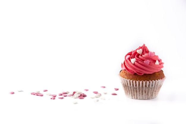 Cupcake decorated with sugar hearts for valentine's day isolated on white background