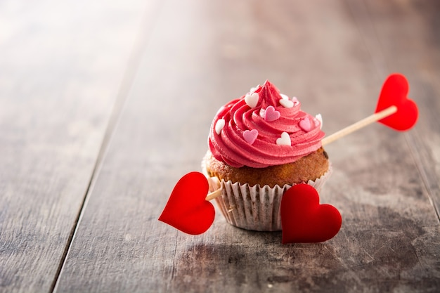 Cupcake decorated with sugar hearts for valentine's day