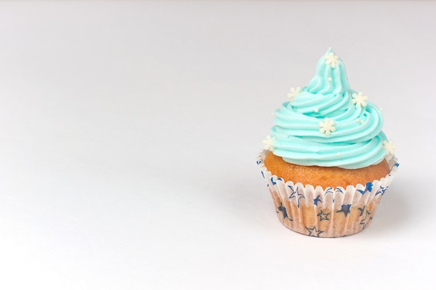 Cupcake decorated with sugar snowflakes and blue cream.christmas winter cupcakes