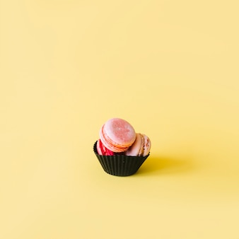 Cupcake liner with macaroons