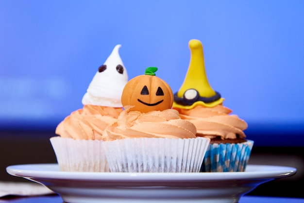 Cupcake pumpkin for halloween on blue