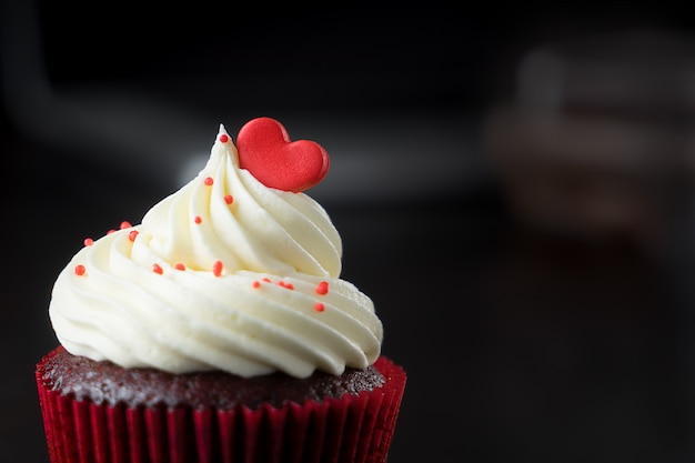 Cupcake topped with red valentines heart