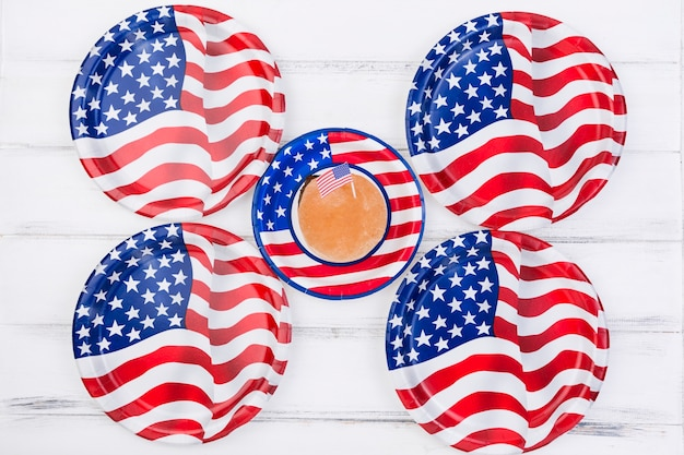Cupcake with american flag and plates in image of american flag