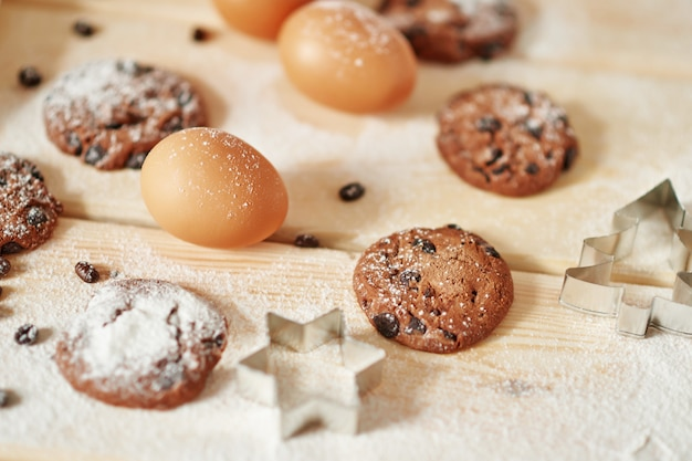 Cupcake with biscuits and eggs on a wooden surface