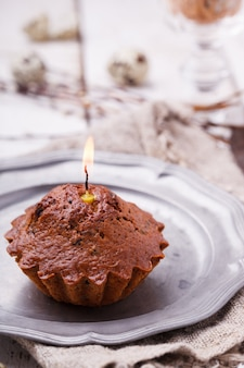 Cupcake with a candle, quail eggs decorating willow.