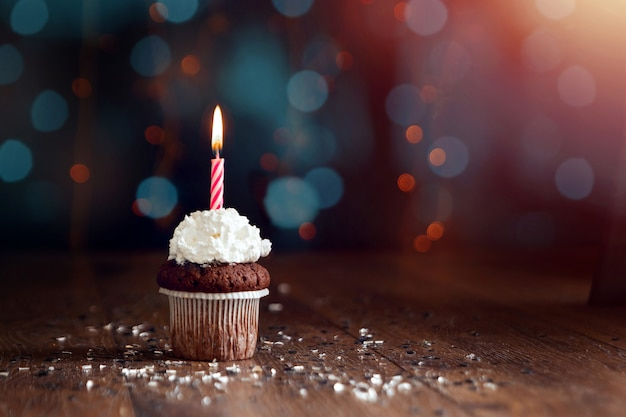 Cupcake with candles, beautiful bokeh. happy birthday