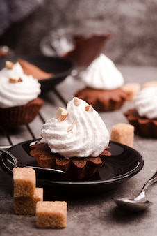 Cupcake with icing and sugar cubes