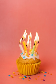 Cupcake with lit candles and copy space