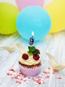 Cupcake with a numeral nine candle