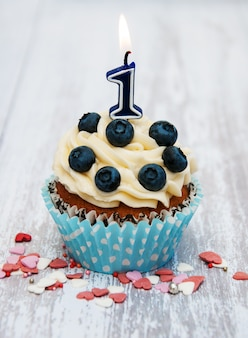 Cupcake with a numeral one candle