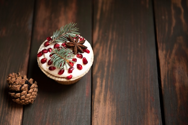 Cupcake with pomegranate and pine cone