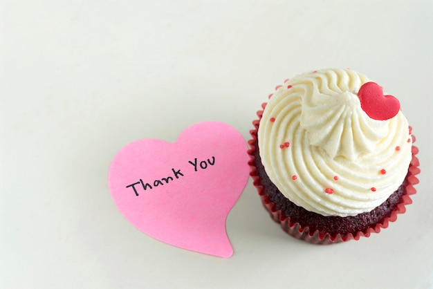 Cupcake with red heart and thank you massage