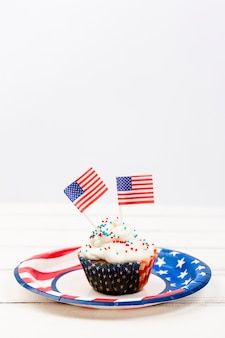 Cupcake with sprinkles and paper flags