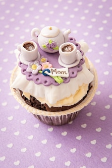 Cupcake with sugar kettle and cups.