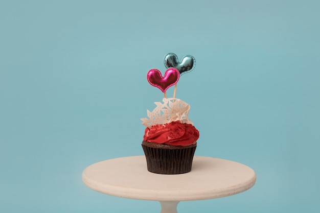 Cupcake with two heart shape decor sweets for valentine's day party or menu