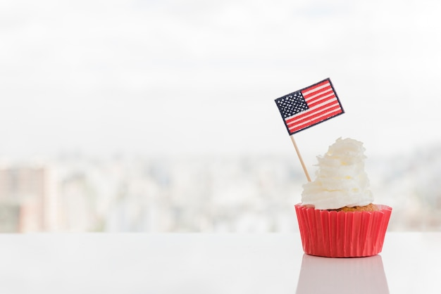 Cupcake with whipped topping and american flag
