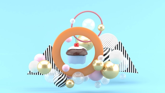 The cupcakes are in the center of the circle among the colorful balls on the blue space