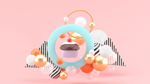 The cupcakes are in the center of the circle among the colorful balls on the pink space