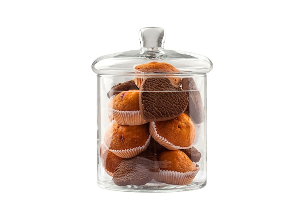 Cupcakes and cookies in the shape of a heart in a glass jar isolate on a white background