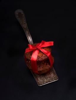 Cupcakes on an iron kitchen spatula, black