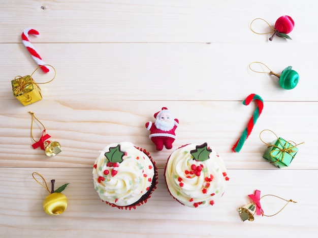 Cupcakes with christmas shape and ornament decoration on wooden table