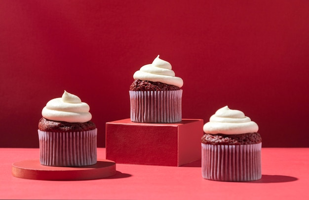 Cupcakes with cream and red background