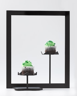 Cupcakes with green creme on black frame