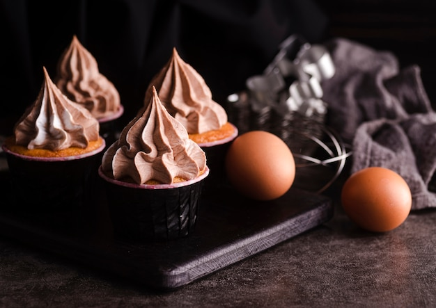 Cupcakes with icing and eggs