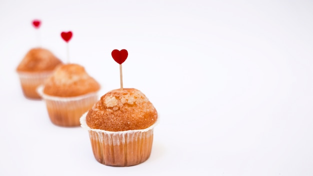 Cupcakes with small heart toppers