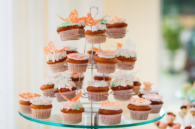 Cupcakes with white cream and orange glaze