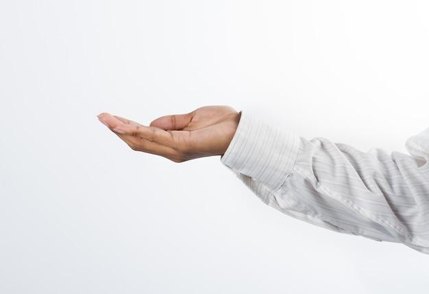 ビジネスマンは開いたcupped手を空にする。譲渡または保持の概念
