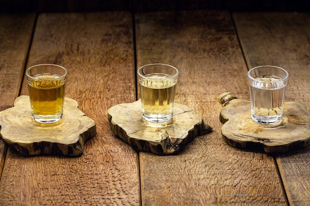 Cups of cachaã§a, a brazilian drink made from sugar cane, a brazilian run popularly called