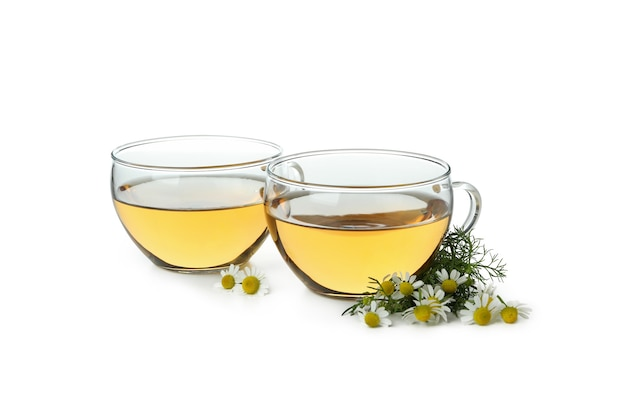 Cups of chamomile tea isolated on white
