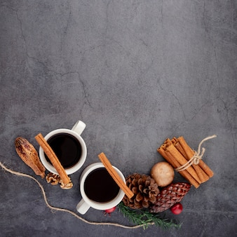 Cups of coffee with cinnamon and spices