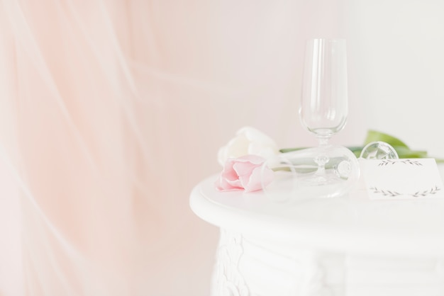 Cups and flowers on table