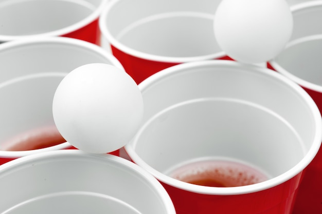 Cups for game beer pong on the table