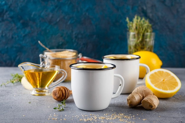 Cups of ginger tea with honey and lemon