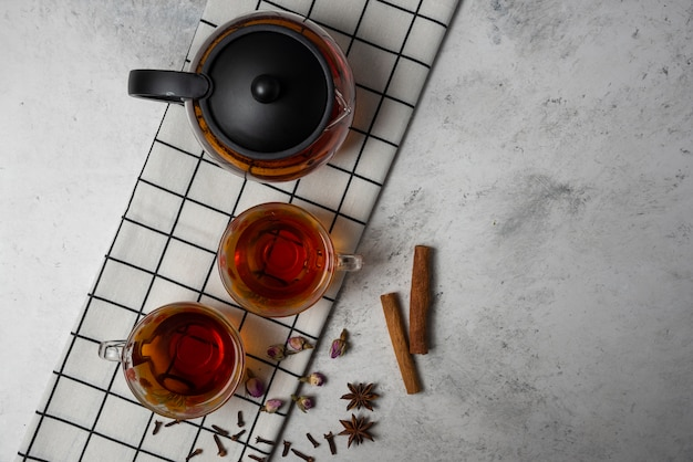 Cups of herbal tea with spices, top view.