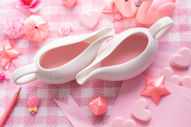Cups of milk, valentine's day holiday celebration background, top view.
