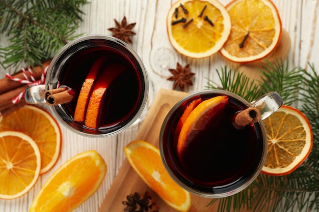 Cups of mulled wine and ingredients