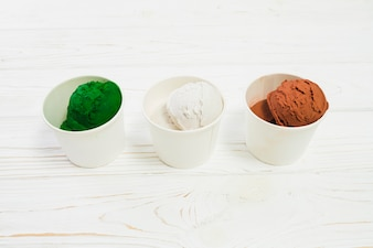 Cups with colorful ice-creams
