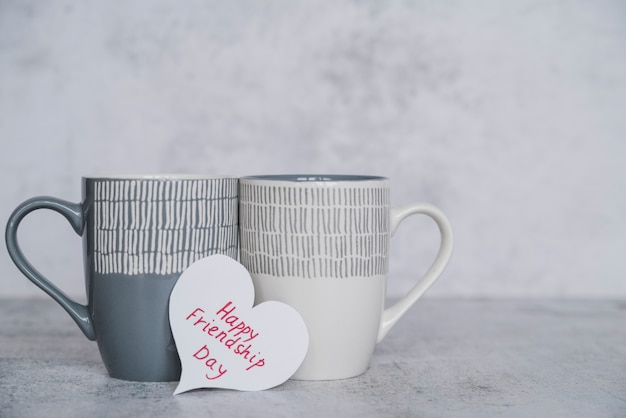 Cups with postcard happy friendship day
