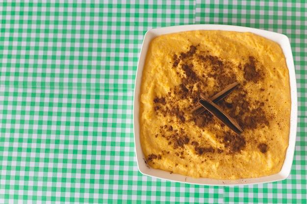 Curau, canjica, angú, sweet corn cream and dessert typical of brazilian cuisine