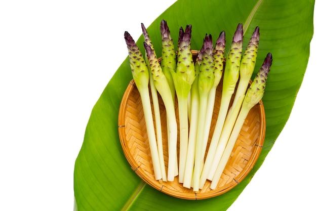 Curcuma sessilis flower in bamboo basket on green leaf