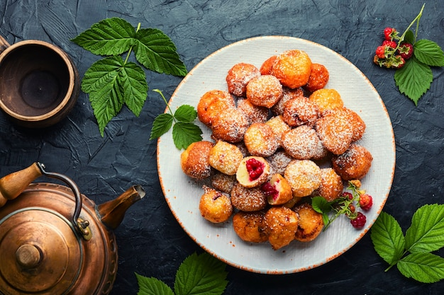 Curd donuts with raspberries for tea