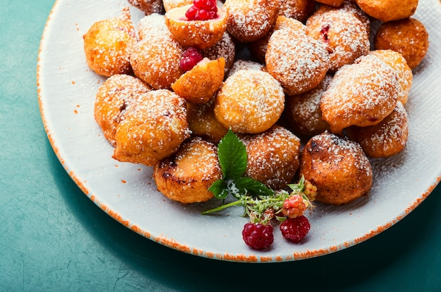 Curd donuts with raspberries